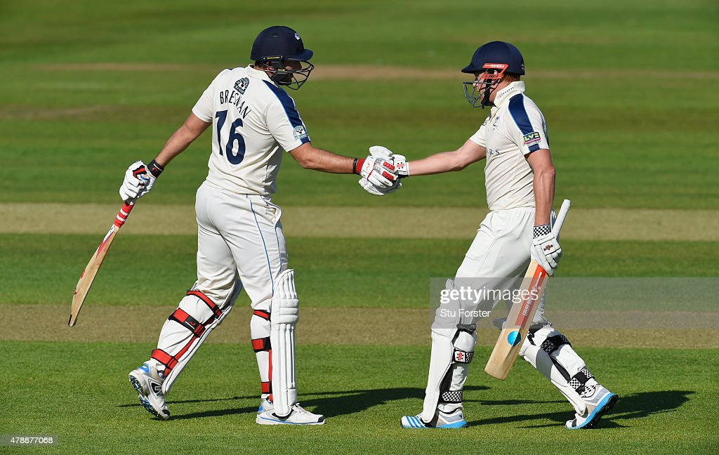 Yorkshire batsman Jonny Bairstow (r) and Tim Bresnan celebrate their 100 partnership during day one of the LV County Championship Division One match between Durham and Yorkshire at Emirates Durham ICG on June 28, 2015 in Chester-le-Street, England.