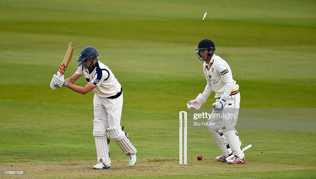 Yorkshire batsman Will Rhodes is bowled by Jamie Harrison as wicketkeeper Michael Richardson looks on during day one of the LV County Championship Division One match between Durham and Yorkshire at Emirates Durham ICG on June 28, 2015 in Chester-le-Street, England.