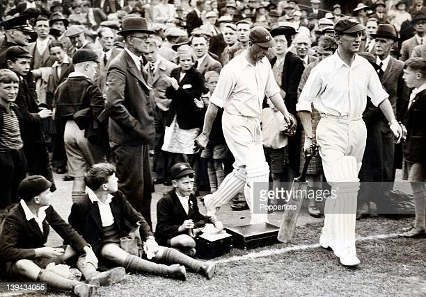 Yorkshire batsmen Len Hutton and Arthur Mitchell walk out to bat at Bramall Lane in Sheffield during their County Championship match against...