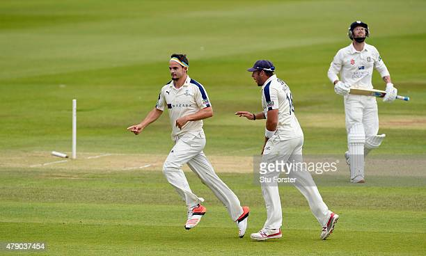 Yorkshire bowler Jack Brooks celebrates with Tim Bresnan after bowling Jamie Harrison during day three of the LV County Championship Division One...