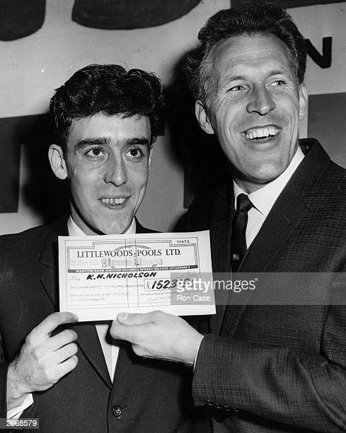 Yorkshire miner Keith Howard Nicholson of Castleford wins a cheque for £152319 on Littlewoods football pools British entertainer Bruce Forsyth...