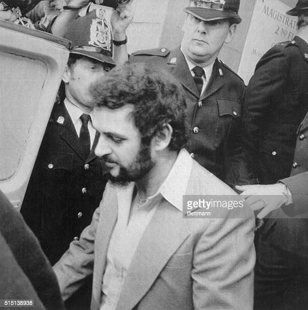 Yorkshire Ripper, Peter Sutcliffe, , is shown leaving court under heavy police guard after giving evidence after which, James Castello, a fellow...