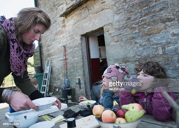 Yorkshire Shepherdess Amanda Owen serves lunch to two of her daughters Violet 3 and Edith 5 at their farm on April 15 2014 near Kirkby Stephen...