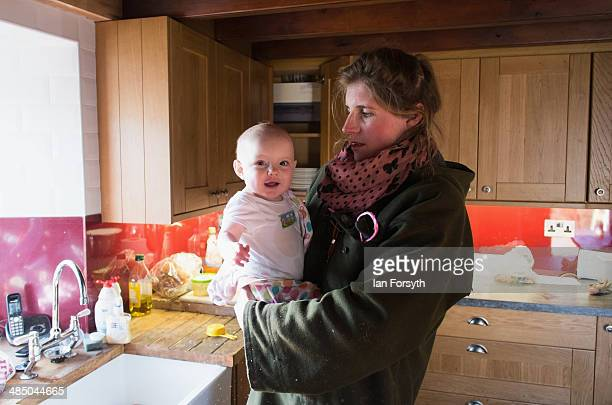 Yorkshire Shepherdess Amanda Owen stands in her kitchen and spends time with her daughter, Annas, 9 months, on April 15, 2014 near Kirkby Stephen,...