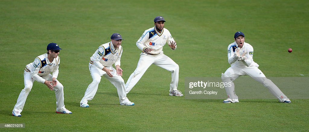 Yorkshire wicketkeeper Andy Hodd fields the ball alongside slipfielders Kane Williamson, Adam Lyth and Adil Rashid during day four of the LV County Championship division One match between Yorkshire and Northamptonshire at Headingley on April 23, 2014 in Leeds, England.