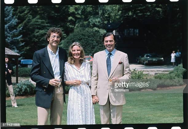 Yorktown Heights, NY- Whiskey tycoon Edgar Bronfman Senior his bride, Georgiana, and son, Sam II Bronfman, hold champagne glasses following the elder...