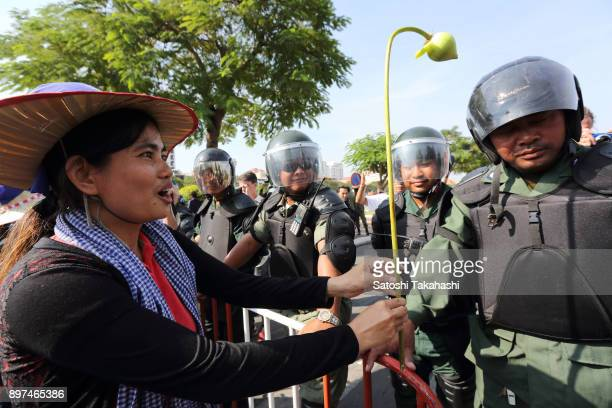Yorm Bopha one of Cambodia's most prominent land rights activists confronts riot police during a demonstration calling for an end to human rights...