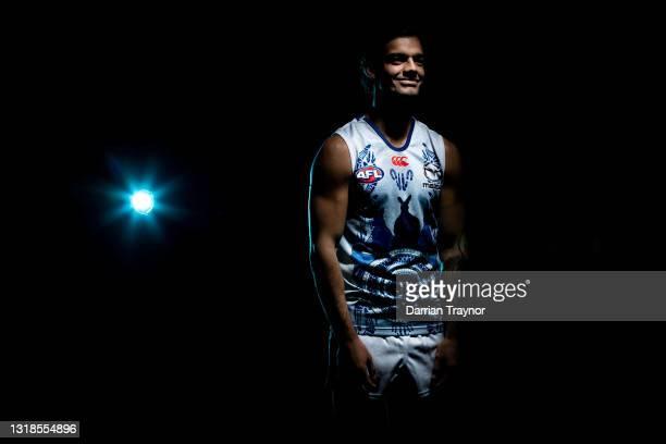 Yorta Yorta man Jy Simpkin poses during a portrait session in the North Melbourne Kangaroos 2021 Sir Douglas Nicholls AFL Round Indigenous Jumper...