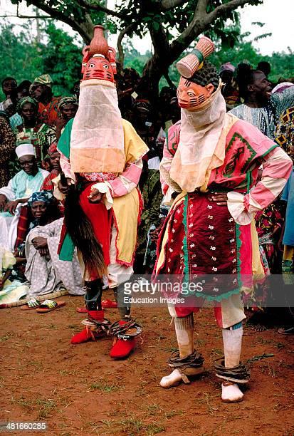 Yoruba Geledi mask dancers at the coronation of the king of Foudite in Benin West Africa