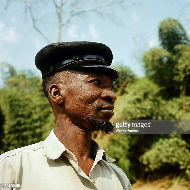 Yoruba man with facial scarification of a type known as abasa worn by members of some families in the Oyo region Nigeria Yoruba Oyo region