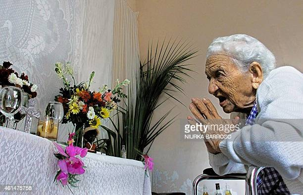 Yoruba spiritual leader Georgina Aguilera prays 04 January during a ceremony in Havana to give thanks to the dead. Yoruba priests are predicting that...