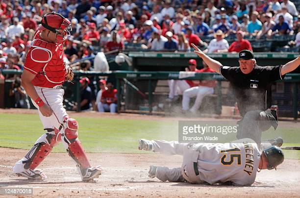 Yorvit Torrealba of the Texas Rangers Ryan Sweeney of the Oakland Athletics and home plate umpire Bill Miller during a baseball game at Rangers...