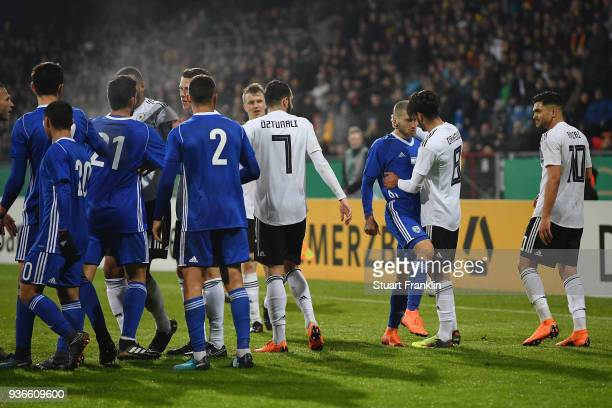 Yosef Raz Meir of Israel argues with Mahmoud Dahoud and Nadiem Amiri of Germany during the 2019 UEFA Under21 European Championship qualifier match...