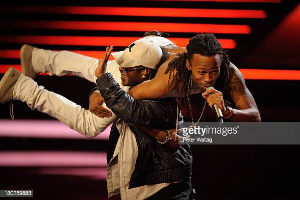 Yosef WoldeMariam and Tshawe Baqwa of Madcon perform on stage during 'The X Factor Live' TVShow on October 25 2011 in Cologne Germany