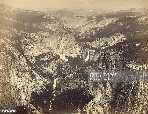 Yosemite Valley in Yosemite National Park California as seen from Washburn Point circa 1865 Pictured are the Vernal Fall and Nevada Fall on the...