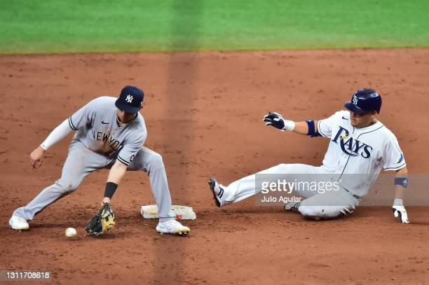 Yoshi Tsutsugo of the Tampa Bay Rays slides into second after hitting a double off of Lucas Luetge of the New York Yankees in the fifth inning at...