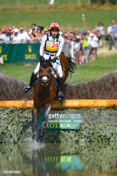 Yoshiaki Oiwa of Japan riding Calle 44 during the obstacle in the water of the Cross Country test DHLPrize in the park of the CHIO of Aachen on July...