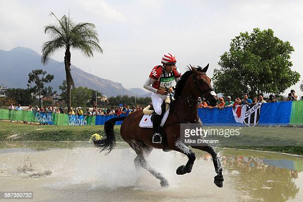 Yoshiaki Oiwa of Japan riding The Duke Of Cavan competes during the Cross Country Eventing on Day 3 of the Rio 2016 Olympic Games at the Olympic...