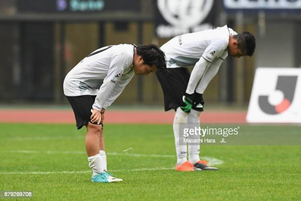 Yoshiaki Takagi and Douglas Vieira of Tokyo Verdy show dejection after their 01 defeat in the JLeague J1 Promotion PlayOff semi final match between...