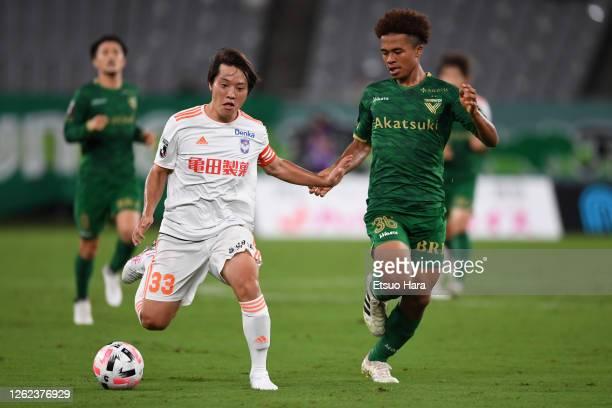 Yoshiaki Takagi of Albirex Niigata and Joel chima Fujita of Tokyo Verdy compete for the ball during the J.League Meiji Yasuda J2 match between Tokyo...