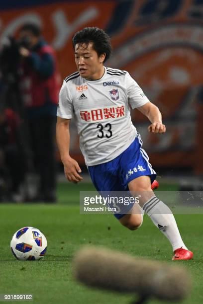 Yoshiaki Takagi of Albirex Niigata in action during the J.League YBC Levain Cup Group A match between FC Tokyo and Albirex Niigata at Ajinomoto...