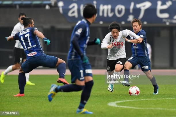 Yoshiaki Takagi of Tokyo Verdy controls the ball under pressure of Avispa Fukuoka defense during the JLeague J1 Promotion PlayOff semi final match...