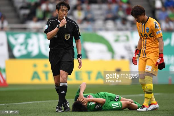 Yoshiaki Takagi of Tokyo Verdy lies injured during the J.League J2 match between Tokyo Verdy and Yokohama FC at Ajinomoto Stadium on May 7, 2017 in...