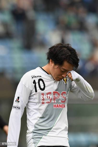 Yoshiaki Takagi of Tokyo Verdy shows dejection after his side's 01 defeat in the JLeague J1 Promotion PlayOff semi final match between Avispa Fukuoka...