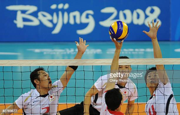Yoshida Hitoshi Nakayama Kaname and Yamamoto Arata of Japan compete against Tong Jiao of China in the Sitting Volleyball match between Japan and...