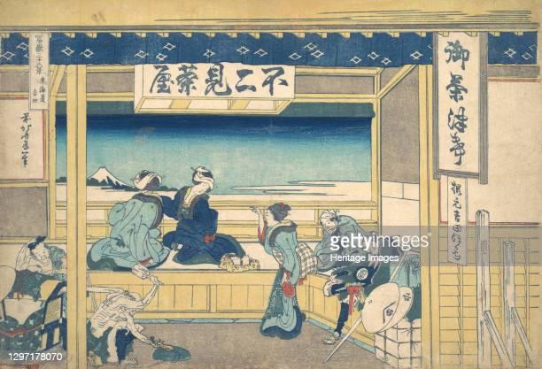 Yoshida on the Tokaido , from the series Thirty-six Views of Mount Fuji , circa 1830-32. Artist Hokusai.