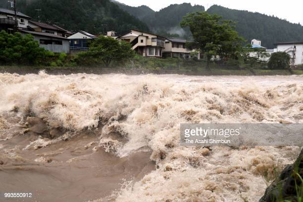 Yoshidagawa River is swollen on July 7 2018 in Gujo Gifu Japan 51 people were killed and 58 missing The deluge triggered by the seasonal rain front...