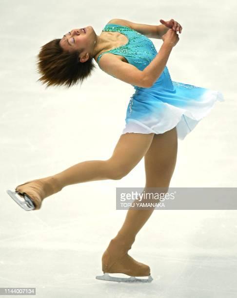 Yoshie Onda of Japan spins during women's short program in the NHK Trophy figure skating competition in Kyoto western Japan 29 November 2002 Onda...