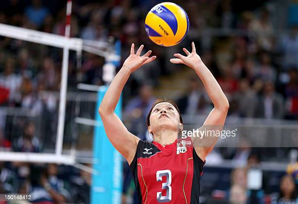 Yoshie Takeshita of Japan sets the ball against Korea during the Women's Volleyball on Day 15 of the London 2012 Olympic Games at Earls Court on...
