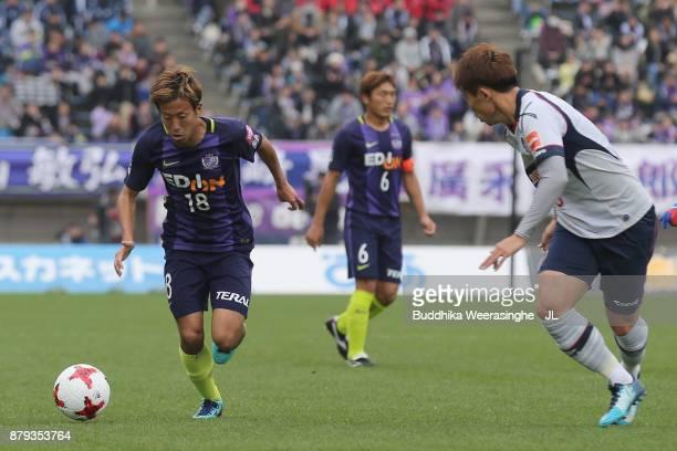 Yoshifumi Kashiwa of Sanfrecce Hiroshima and Kosuke Ota of FC Tokyo compete for the ball during the JLeague J1 match between Sanfrecce Hiroshima and...