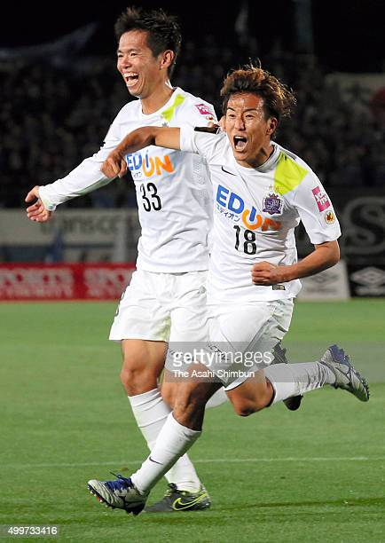 Yoshifumi Kashiwa of Sanfrecce Hiroshima celebrates scoring his team's third goal with his team mate Tsukasa Shiotani during the JLeague Championship...