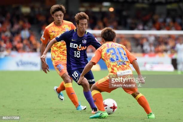 Yoshifumi Kashiwa of Sanfrecce Hiroshima takes on Shota Kaneko of Shimizu SPulse during the JLeague J1 match between Shimizu SPulse and Sanfrecce...