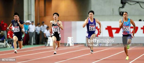 Yoshihide Kiryu and Aska Cambridge compete in the Men's 100m semi final during day one of the 101st JAAF Athletics Championships at Yanmar Stadium...