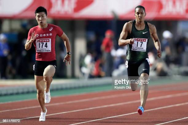 Yoshihide Kiryu and Aska Cambridge compete in the Men's 100m semifinal on day one of the 102nd JAAF Athletic Championships at Ishin MeLife Stadium on...