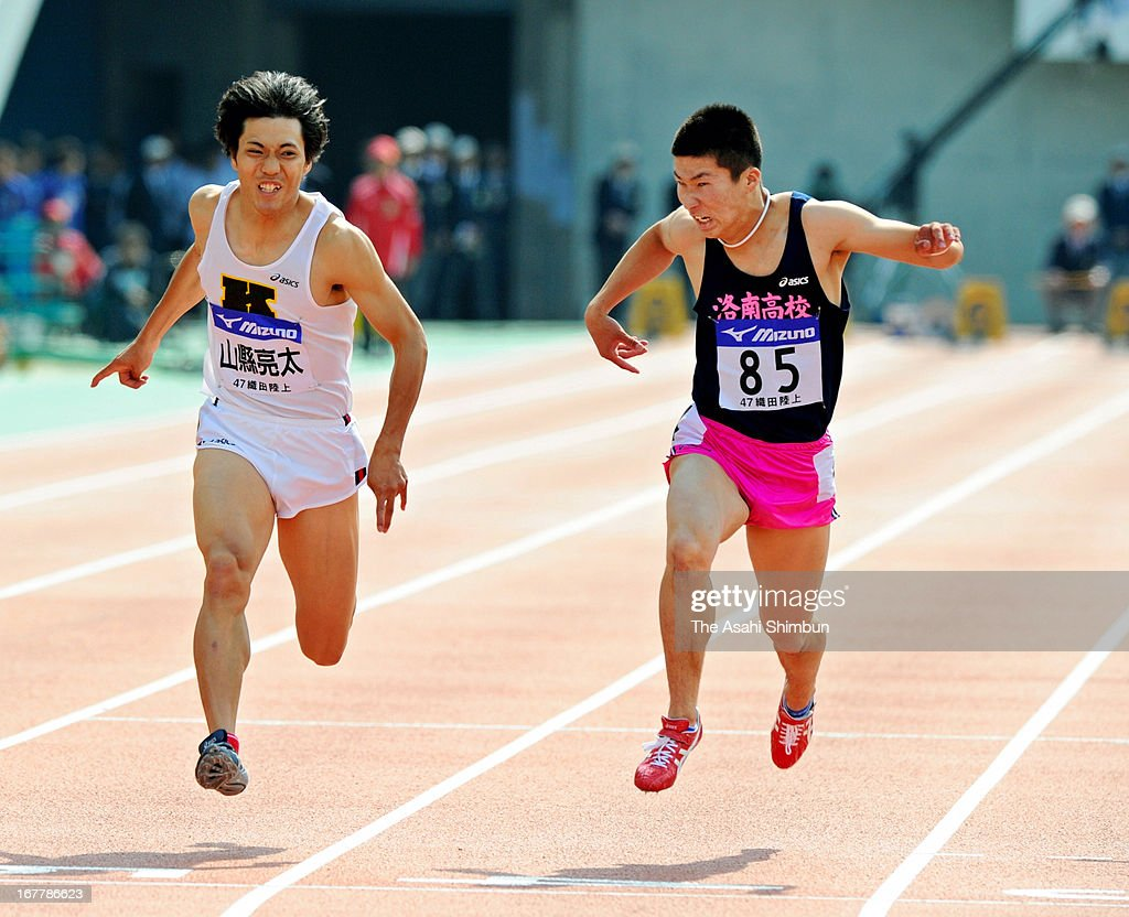 Yoshihide Kiryu (R) and Ryota Yamagata (L) compete in the Men's 100m Final during the Mikio Oda Memorial Athletics Championships at Edion Stadium Hiroshima on April 29, 2013 in Hiroshima, Japan.