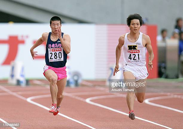 Yoshihide Kiryu and Ryota Yamagata of Japan in action during the Men's 100m sprint on day two of the 97th Japan Track and Field Championships at...