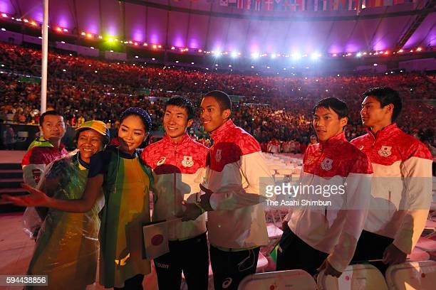 Yoshihide Kiryu Aska Cambridge Shota Iizuka and Ryota Yamagata pose for photographs during the Closing Ceremony on Day 16 of the Rio 2016 Olympic...