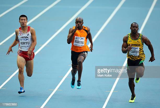 Yoshihide Kiryu of Japan Churandy Martina of the Netherlands Nesta Carter of Jamaica compete in the Men's 100 metres heats during Day One of the 14th...