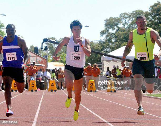 Yoshihide Kiryu of Japan competes in the Invitational Men 100m on day four of the 2015 Texas Relay at Mike A Myers Stadium on March 28 2015 in Austin...