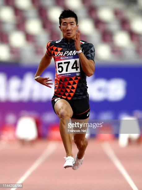 Yoshihide Kiryu of Japan competes in the men's 100m heats during the 23rd Asian Athletics Championships Day One at Khalifa International Stadium on...