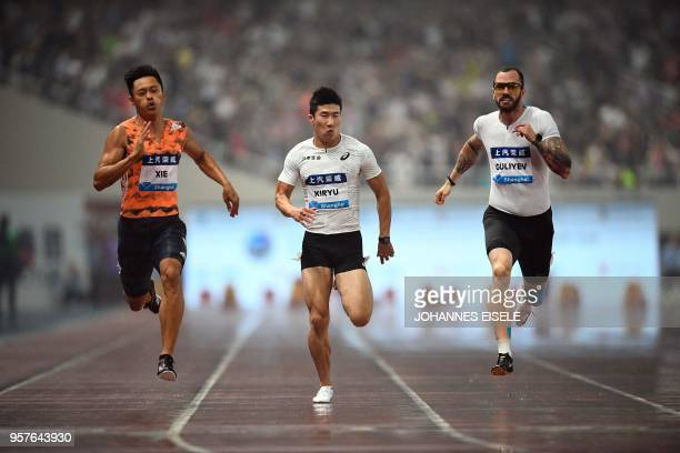 Yoshihide Kiryu of Japan, Ramil Guliyev of Turkey and Xie Zhenye of China compete during the men's 100m event of the IAAF Diamond League Shanghai...