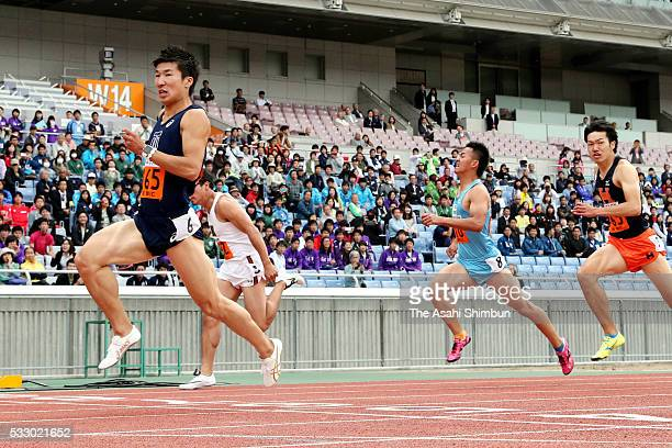 Yoshihide Kiryu of Toyo University crosses the finishing line to win the Men's 100m final during day two of the Kanto Students Athletics...