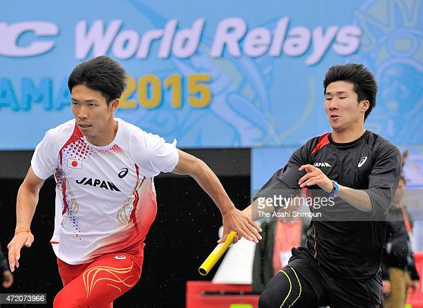 Yoshihide Kiryu passes the baton to Kotaro Taniguchi during a training session ahead of the men's 4 x 100 metres of the IAAF World Relays at Thomas...