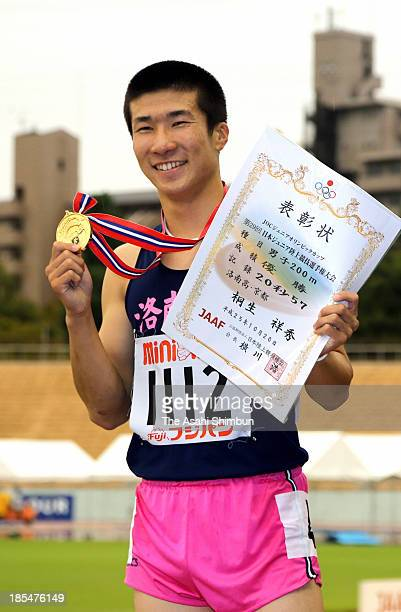 Yoshihide Kiryu poses for photographs after winning in the Men's 200m during the JAAF Junior Youth Championships at Mizuho Stadium on October 20,...