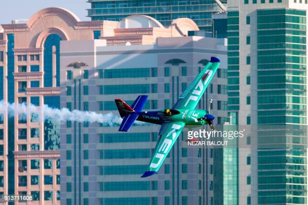 TOPSHOT Yoshihide Muroya of Japan manoeuvres his plane through obstacles during the 2018 Red Bull Air Race World Championship in the Emirati capital...