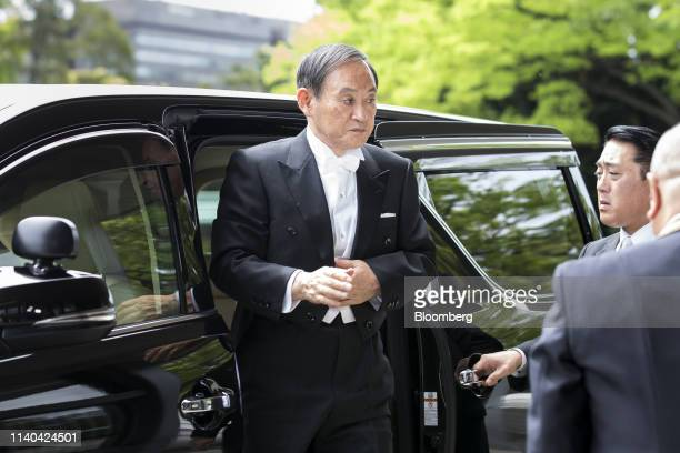 Yoshihide Suga Japan's chief cabinet secretary arrives for Emperor Naruhito's ascension ceremony at the Imperial Palace in Tokyo Japan on Wednesday...